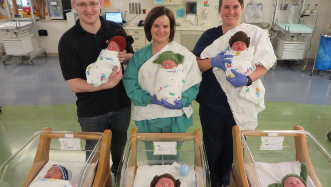 Mercy Medical Center babies born on May Fourth were welcomed with Star Wars themed hats made by a friend of nurse Megan Summer, pictured in the top right.