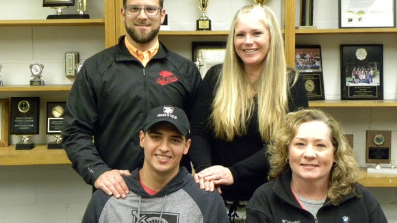 Glen Rock High School's Kyle Patel celebrates signing day with his mother, Lori Patel, and Track and Field coaches J.P. McCarten and Stacie Gallo.  Kyle served as a junior and senior captain for the Panthers' winter and spring track and field programs.  He is a coach among the athletes, providing valuable feedback to the coaching staff on a daily basis.  Some of Kyle's accolades include: 6th in the state as a junior in discus; 5th in the state as a senior in indoor shot; the current leader in Bergen County outdoor discus; and Glen Rock record holder for discus.  Kyle will compete for The United States Military Academy at West Point next year.