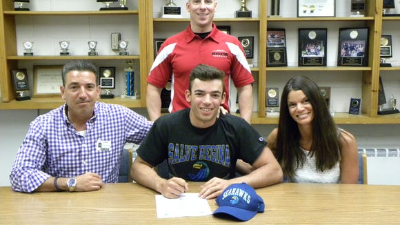Glen Rock High School senior Dominic Patania has committed to continue his football career at Salve Regina University in Newport, R.I. On hand to congratulate Dom are parents Lance and Maria, along with GRHS Head Football Coach Jim Kurz (standing.) Dom was a two-year varsity starter for the Panthers, starting at quarterback his senior year. He was named 1st Team All-League Selection and served as senior captain this year.