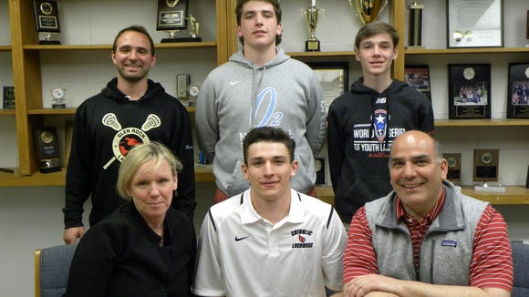 Glen Rock High School senior Thomas Consoli is joined by his family - parents Ralph and Meghan Consoli, and brothers Colin and Will - as he signs his commitment letter to play Division 3 lacrosse for The Catholic University of America in Washington D.C.  Also on hand to congratulate Thomas is Varsity Boy's Lacrosse Coach Michael Escalante, standing at left. Thomas is a three-year varsity lacrosse player at midfield and attack for Glen Rock and has been one of the team's top players for the past three years. Thomas has been a tremendous offensive threat for the team and especially this season. He will continue his career as a midfielder for Catholic.