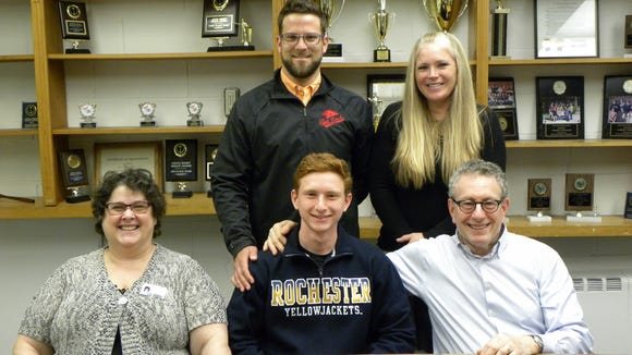 Glen Rock's Jarod Forer is congratulated by his parents, Judi and Howard Forer, along with his coaches, J.P. McCarten and Stacie Gallo, on his commitment to the Rochester Institute of Technology to compete as a multi-event athlete in track and field.  Jarod is a senior captain for the winter and spring programs.  He is a tremendous leader both on and off the track.  Jarod excelled in many events including: long jump, 100m, 200m, 400m, and 800m.  In his best event, pole vault, Jarod holds the Glen Rock High School record at 14-0 ft.