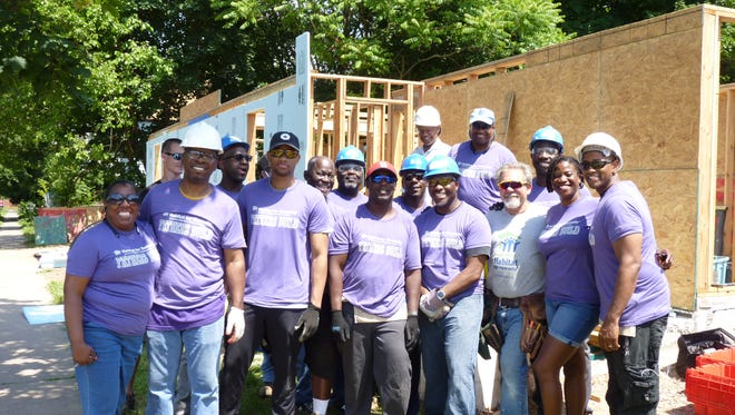 Volunteers with Habitat for Humanity building a home in Plainfield before Father's Day.