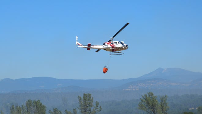 Helicopters dropped water while air tankers spread retardant in the Millville area Saturday to contain the 350-acre Bascom Fire.