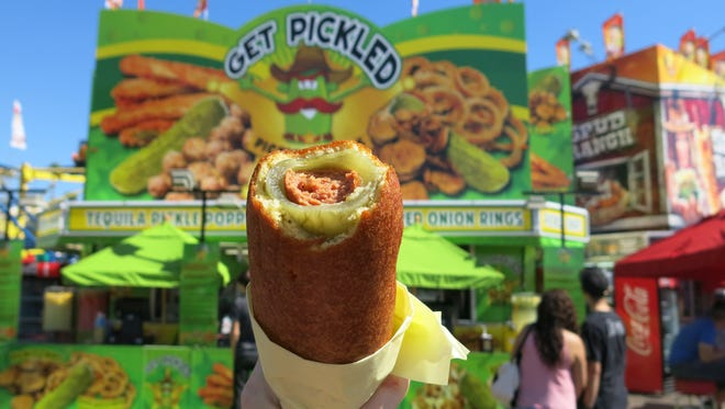 A hot dog, inside a hollowed dill pickle, battered and deep-fried. Pick-o-Pete's calls that a pickle dog. I call it amazing. This is huge, the hot dog thick and juicy and the dill pickle, though hollowed, substantial, all fried in crispy golden breading. Don't be scared of the dill pickle — it's got the tang of eating a hot dog with relish, and a dab of mustard takes the whole thing to the next level. $10.