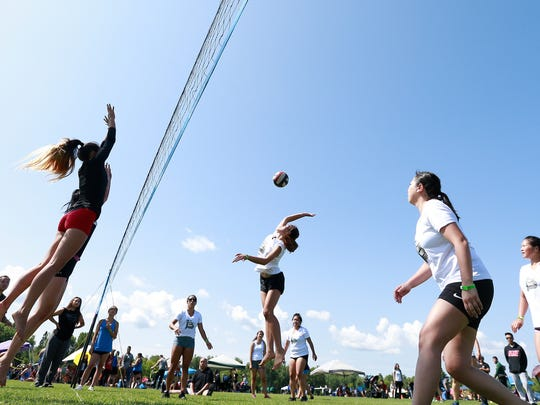 Women volleyball players compete July 28, 2018, during the second annual Hmong Wausau Festival at the Eastbay Sports Complex in Wausau.