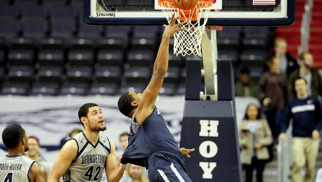 Dec 15, 2015; Washington, DC, USA; Monmouth Hawks center Zac Tillman (33) is fouled by Georgetown Hoyas center Bradley Hayes (42) in the first half at Verizon Center. Mandatory Credit: Evan Habeeb-USA TODAY Sports