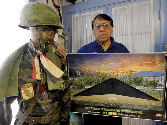 "Joe ""China Boy"" Lopez holds up a poster with a depiction of what the proposed Vietnam Veterans Memorial would look like if the funds necessary to build it are raised. The memorial would be built at Old Glory Memorial in Northeast El Paso at 9550 Gateway  North."