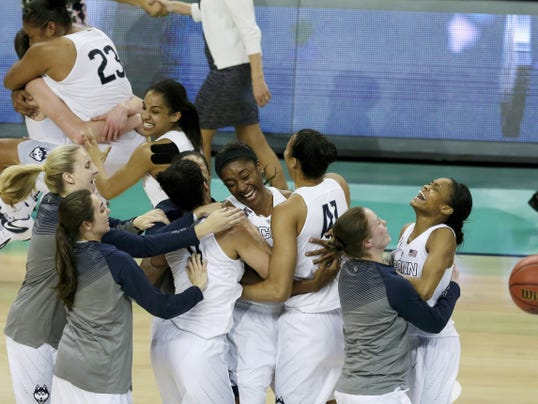 Connecticut players celebrate after beating Notre Dame, 63-53, for the NCAA basketball women's national championship on Tuesday in Tampa, Fla. Kaleena Mosqueda-Lewis and Moriah Jefferson each scored 15 points to give the Huskies their third straight championship and 10th overall, tying Geno Auriemma with John Wooden for the most titles in college basketball. UConn's coach has now won all 10 of his trips to the national championship game. The Huskies have won five of the last seven titles.