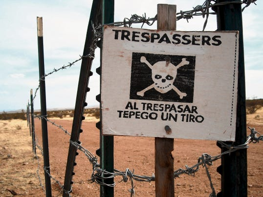 Headlight File Photo   Signs along the border in Southwestern New Mexico warn trespassers they are in a danger zone when crossing through fence ranch land and rural private properties.