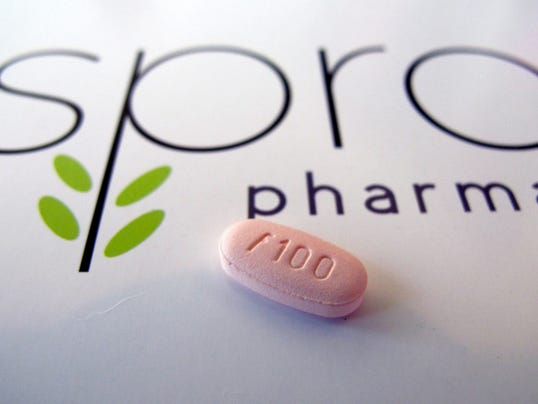A tablet of flibanserin sits on a brochure for Sprout Pharmaceuticals in the company's Raleigh, North Carolina, headquarters. The Food and Drug Administration on Tuesday approved the first prescription drug designed to boost sexual desire in women, a milestone long sought by a pharmaceutical industry eager to replicate the blockbuster success of impotence drugs for men. (AP Photo/Allen G. Breed)
