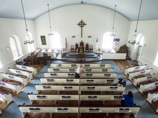 Pastor Charles Best talks to visitors on the church's anniversary tour Sunday at the Great Conewago Presbyterian Church in Straban Township.