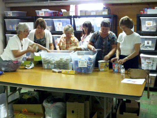 Volunteers sort through food supplies that will be distributed to needy students in the Littlestown Area School District. From left, are Sue Mauck, coordinator; Kim McMaster; Kerry Abruzzo; Candy Rule; Sharri Plattenburg; and Linda Newman.