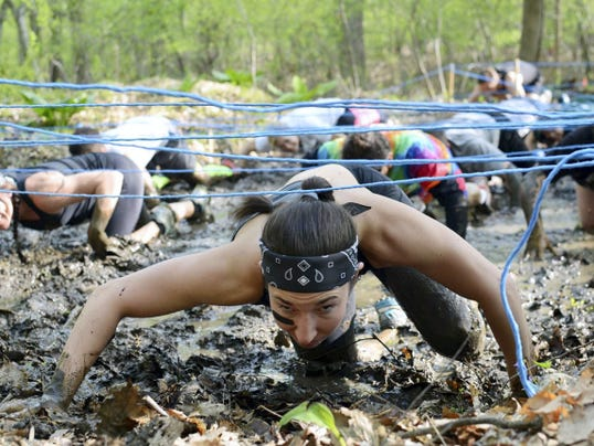 Competitors go through the mud crawl at last year's Gretna Gritty.