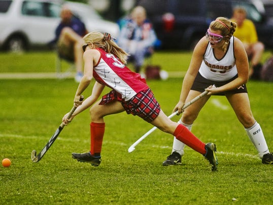 Bermudian Springs' Mackenzie Farley pushes the ball up field past Hanover's Emily Albright during a YAIAA Division III game in 2012. Farley is back for the defending champion Eagles, but Albright — an all-star goalie — has graduated.
