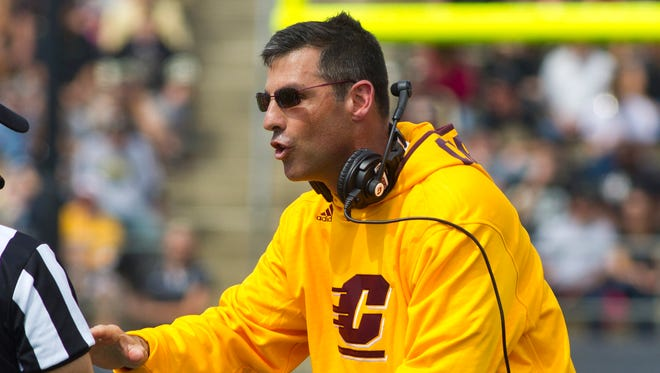 Central Michigan football coach Dan Enos questions a call against Purdue on Sept.  6, 2014.