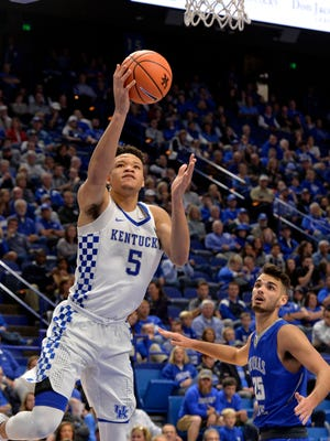 Kentucky Wildcats forward Kevin Knox (5) goes up for a layup past the defense of Thomas More forward Austin Young (25), during the second half of their game, Friday, Oct. 27, 2017 in Lexington Ky. Kentucky won 103-61.