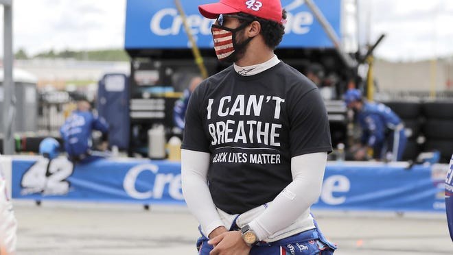 "Bubba Wallace wears an ""I Can't Breath, Black Lives Matter"" shirt before Sunday's NASCAR Cup Series race at Atlanta Motor Speedway."