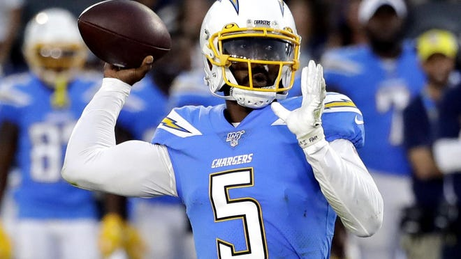 Los Angeles Chargers quarterback Tyrod Taylor throws the ball downfield against the Seattle Seahawks during the first half of an Aug. 25, 2019, game in Carson, California. Taylor is expected to succeed Philip Rivers, who started the past 14 seasons before signing with Indianapolis.