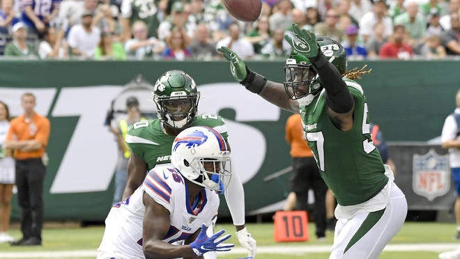 New York Jet C.J. Mosley (right) breaks up a pass intended for the Buffalo Bills' John Brown during a Sept. 8, 2019, game in East Rutherford, New Jersey. A total of 66 players have opted out of the 2020 NFL season due to the coronavirus pandemic, including Mosley.