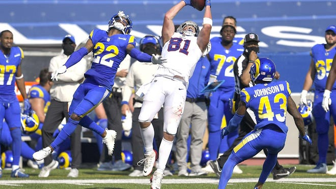 Buffalo Bills tight end Tyler Kroft (81) catches a pass in front of Los Angeles Rams Troy Hill (22) and John Johnson (43) during the second half of Sunday's game in Orchard Park, New York.