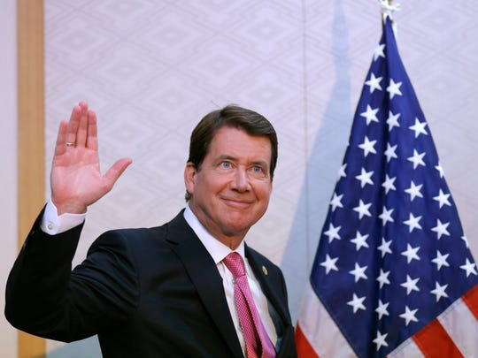 New U.S. Ambassador to Japan Bill Hagerty waves during a news conference upon his arrival at Narita International Airport in Narita, east of Tokyo, Thursday, Aug. 17, 2017.