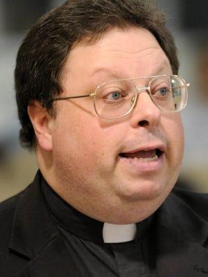 The Rev. Jerry Priscaro of St. Ann Catholic Church.