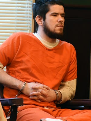 Erik Cunningham was in Judge Laurie Pittman's courtroom for a competency hearing in April 2019.