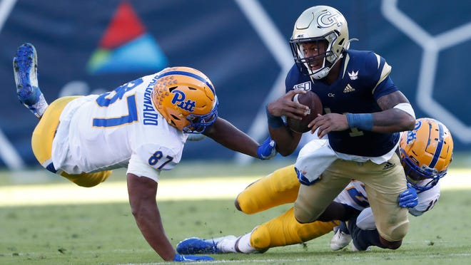 Georgia Tech quarterback James Graham (4) is brought down by Pittsburgh defensive back Paris Ford (12) and Pittsburgh defensive lineman Habakkuk Baldonado (87) after a short gain in the first half of an NCAA college football game Saturday, Nov. 2, 2019, in Atlanta. (AP Photo/John Bazemore)