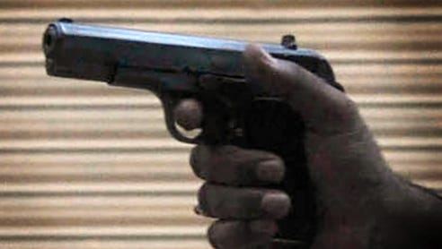 This file photo shows a person pointing a handgun.