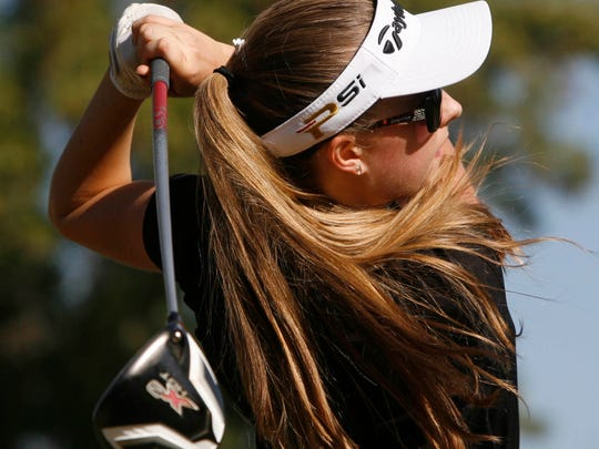Mazarine Penzin of Newbury Park High hits her tee shot on the 18th at Los Robles Greens Golf Course Monday during the CIF-SS Northern Divison Team Championship Tournament.