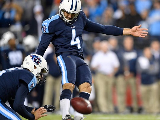 Titans place kicker Ryan Succop (4) kicks his fifth field goal of the game Monday night.