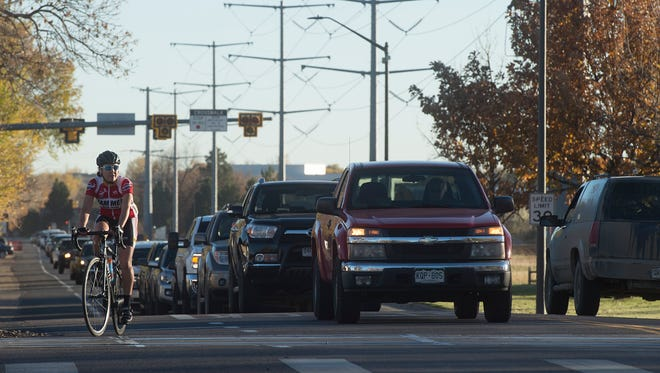 Evening traffic waits to proceed northbound on Lemay Avenue at the intersection of Vine Drive in October 2017.