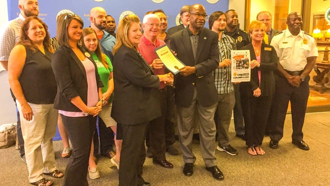 Hattiesburg Mayor Johnny DuPree, center, presents a proclamation to St. Joseph Hospice Executive Director Sandy Ladnier, sponsors and participants during a recent press conference. DuPree proclaimed July 23 as First Responders Are Superheroes Day.