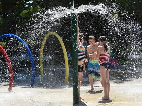 Children play in the water at Wildwood Splash Park on Wednesday, July 1, 2015, in Aumsville.