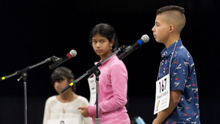 Donald McBath, right, competes in the17th Annual Tulare County Spelling Championship hosted 240 spellers at the Visalia Convention Center on Wednesday, February 24, 2016. McBath placed third.
