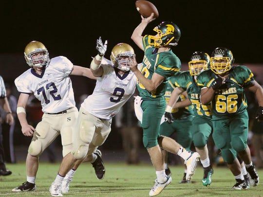 Salesianum's Troy Reeder (9) pressures St. Mark's quarterback Zach Whitehead in Oct. 2013.