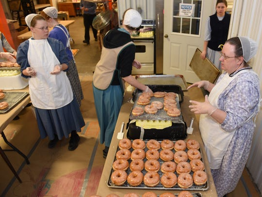 Linda Null, far right, and her daughters and workers spent most of the day filling orders Monday, February 8, 2016 at Country Breeze Produce, Molly Pitcher Highway, Marion. Area bakeries were getting ready for Fasnacht Day, an annual Pennsylvania Dutch celebration.