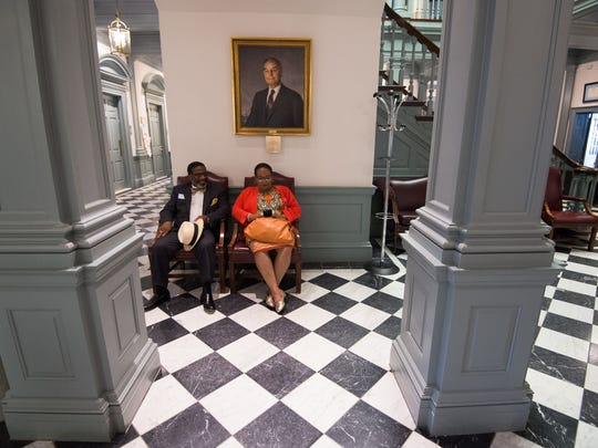 Rourke Moore and Jacqueline Jenkins of Wilmington wait in the lobby of Legislative Hall in Dover on Wednesday for the House of Representatives to address a bill regarding Wilmington school redistricting. Lawmakers are in the final stretch before the session ends Thursday.