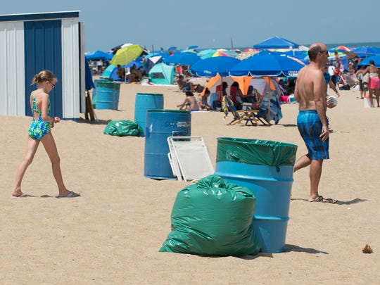 Trash cans on the beach at Rehoboth Beach, Del,.