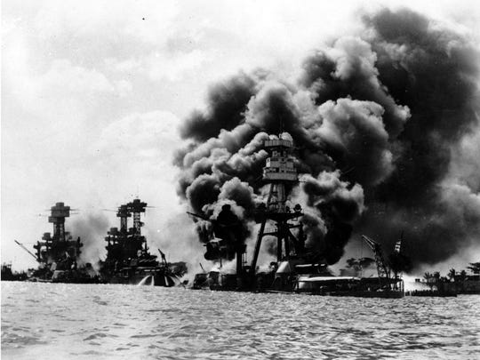 FILE--Three U.S. battleships are hit from the air during the Japanese attack on Pearl Harbor in this Dec. 7, 1941 file photo. From left are: USS West Virginia, USS Tennessee, both damaged; and USS Arizona, sunk. The terrorist assualts that occured Tuesday, Sept. 11, 2001, on the World Trade Center and at the Pentagon reminded many Pearl Harbor survivors of the 1941 Japanese attack on U.S. warships in Hawaii. (AP Photo/File)