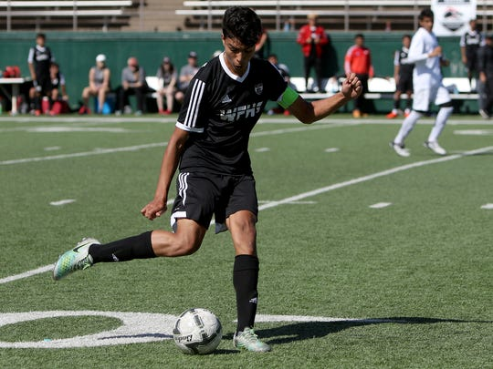 Wichita Falls High School's Alfredo Pacheco passes in the match against El Paso Del Valle Saturday, April 8, 2017, at Memorial Stadium. The Coyotes defeated the Conquistadores 1-0 to advance to their first UIL Soccer State-Tournament.