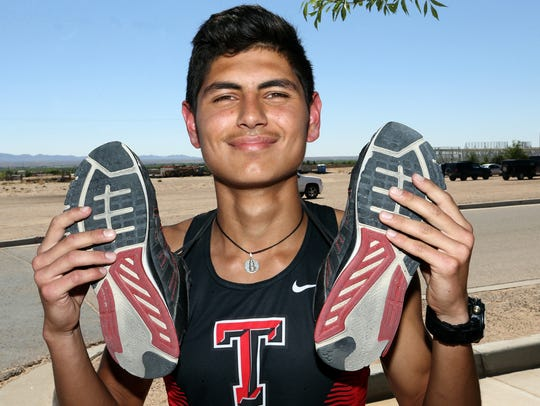 Daniel Amaya's shoes show the wear and tear of training