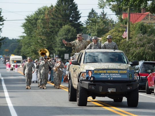 The Delaware National Guard leads the 24th annual Middletown Old-Tyme Peach Festival parade.