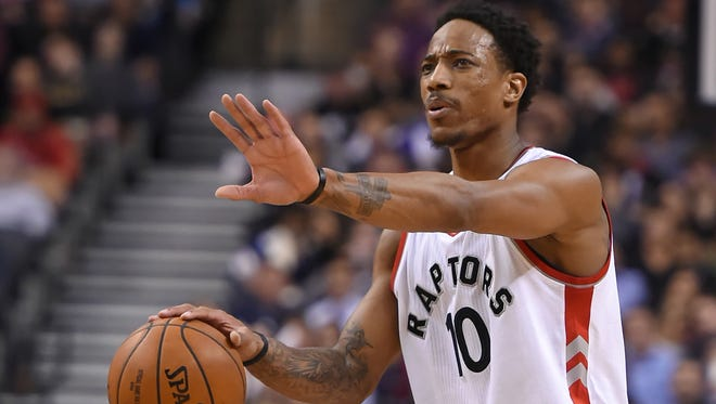 Toronto Raptors guard DeMar DeRozan (10) gestures from the court during the fourth quarter against the Los Angeles Clippers at Air Canada Centre.