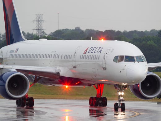 A Delta Air Lines Boeing 757-200 taxies to the gate