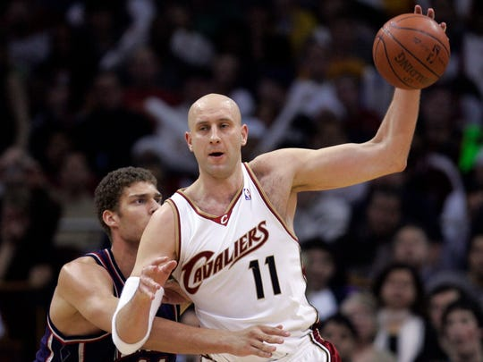 Cleveland Cavaliers' Zydrunas Ilgauskas (11), of Lithuania, looks for help under pressure from New Jersey Nets' Brook Lopez (11) in the third quarter in an NBA basketball game, Wednesday, March 25, 2009, in Cleveland. The Cavaliers won 98-87. (AP Photo/Tony Dejak)
