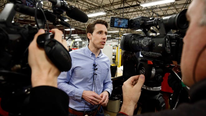Josh Hawley chats with media after launching his campaign for the U.S. Senate at Positronic in west Springfield on March 13, 2018.
