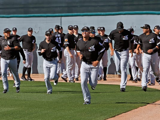 Chicago White Sox pitcher Jose Quintana, middle, leads a group of pitchers as they run sprints at the White Sox baseball spring training facility Wednesday, Feb. 15, 2017, in Glendale, Ariz. (AP Photo/Ross D. Franklin)