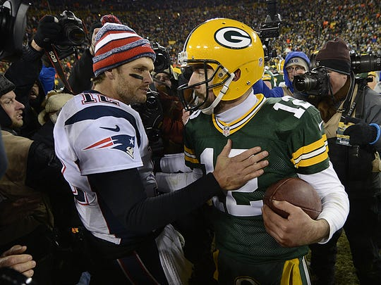 Green Bay Packers quarterback Aaron Rodgers and New England Patriots quarterback Tom Brady exchange words after a Nov. 2014 at Lambeau Field.