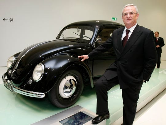 Former Volkswagen CEO Martin Winterkorn, seen here posing with a 1950 VW Beetle, resigned shortly after the company's emissions scandal erupted.